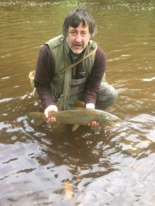 Angler with big sea trout from River Ribble